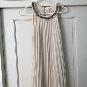 En Creme semi formal dress